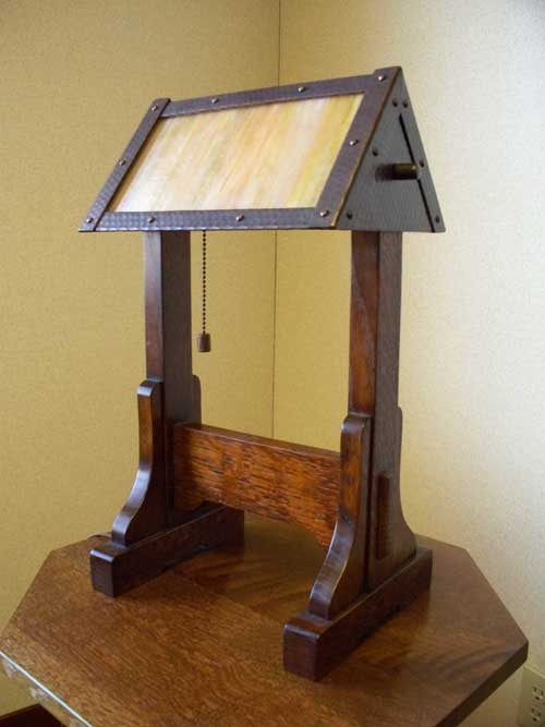 arts and crafts stickley reproduction style table lamp of stained quartersawn oak with hand crafted art glass with adjustable hand hammered copper shade