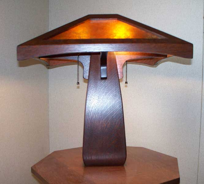 arts and crafts style table lamp of stained quartersawn oak with hand crafted art glass
